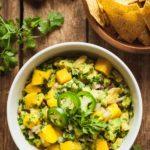 Mango Salsa with Avocado - A delicious Mexican dip that can also be used for baked fish, steak, tofu, and more! Fast and easy. #fast #easy #mexican #dip #party #food #picnic #tortillachips #mango #avocado #salsa