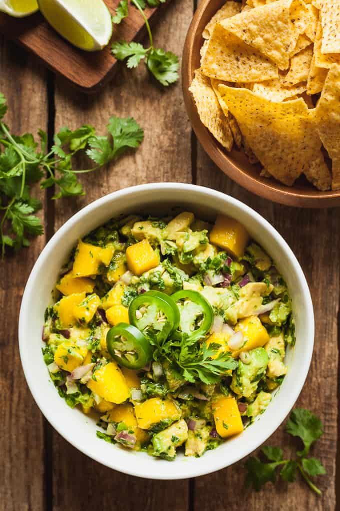 a bowl of mango avocado salsa with chips