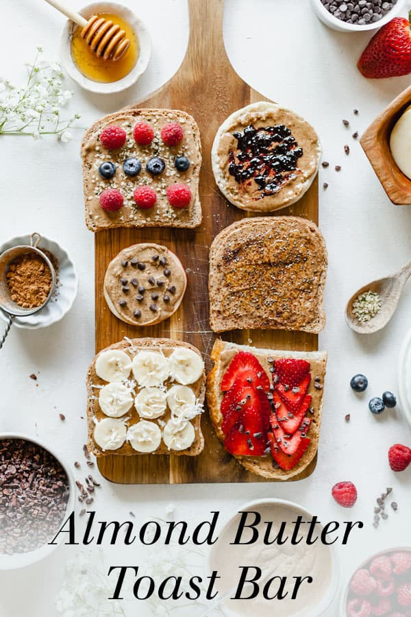 An almond butter toast bar is the most delicious way to enjoy this healthy nut butter! Including recipes for my favorite combinations of toppings, this is an easy party snack or appetizer that you need to make! #partyfood #appetizer #snack #healthy #babyshowerfood #bridalshowerfood #mothersday #mothersdayfood