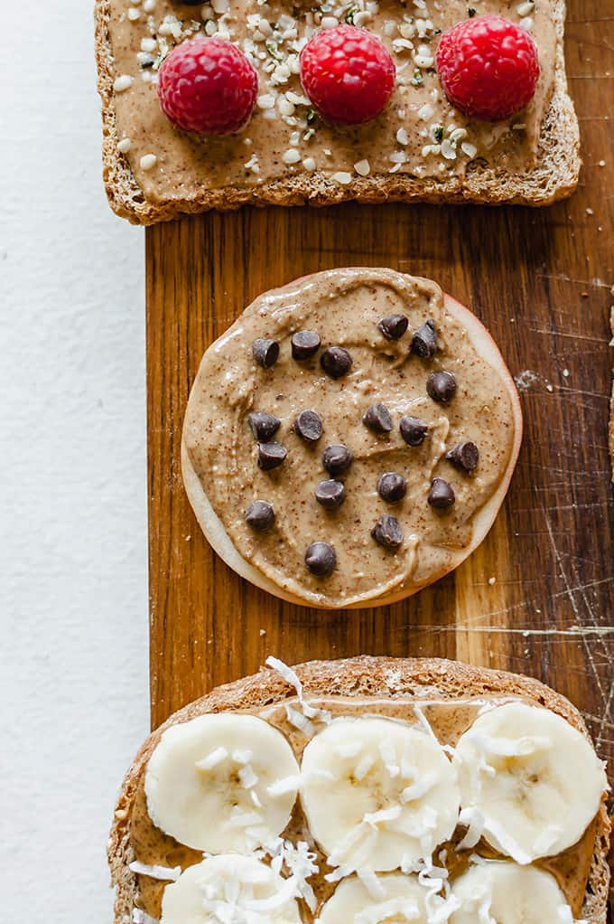 top view images of three almond butter toasts. topped with raspberries, chocolate chips, bananas and coconut