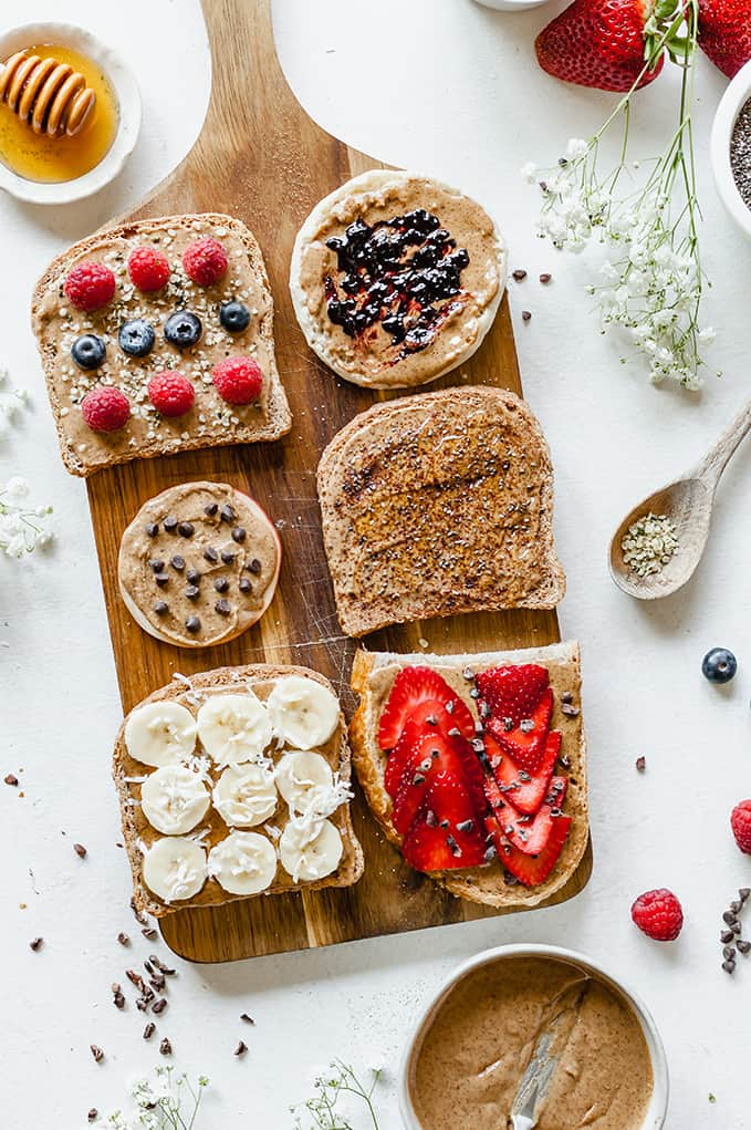 top view image of almond butter toast bar with different toppings on them.