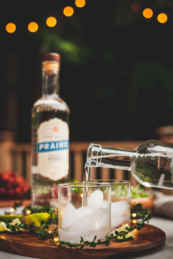 An Organic Date Night at Home - Dinner made with natural ingredients, lights strung across a wooded nook, and crisp summer cocktails make a romantic setting for a date. #vodkatonic #vodkacocktails #datenight #datenightideas #datenightathome