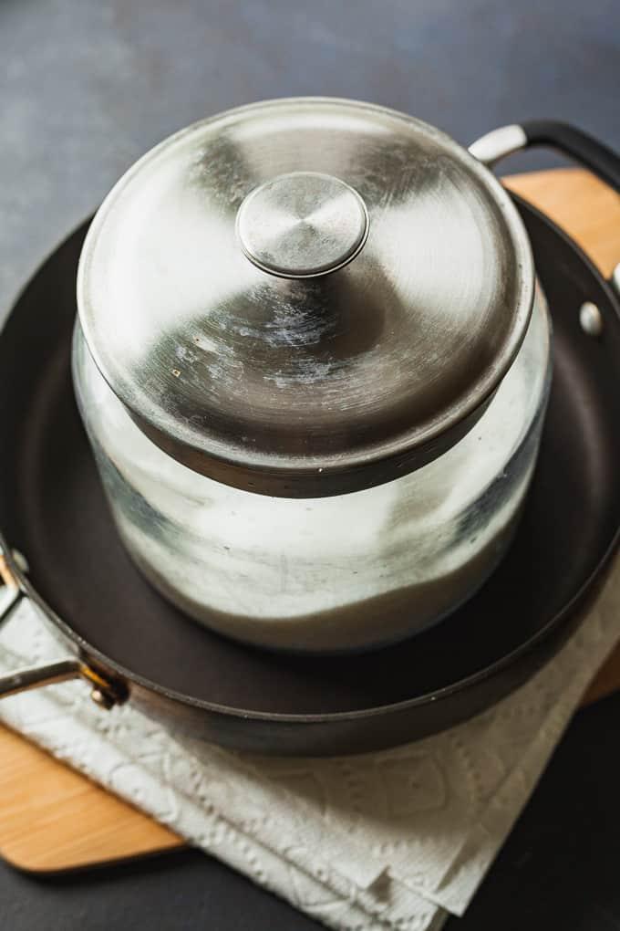 a heavy jar pressing tofu