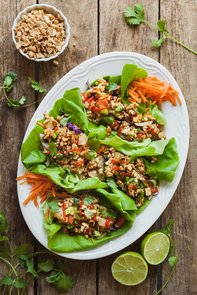 Healthy Vegan Lettuce Wraps - An easy vegan dinner idea made with tempeh, veggies, and seasoned with soy sauce and ginger! #easy #dinnerideas #veganrecipes #vegan #tempeh