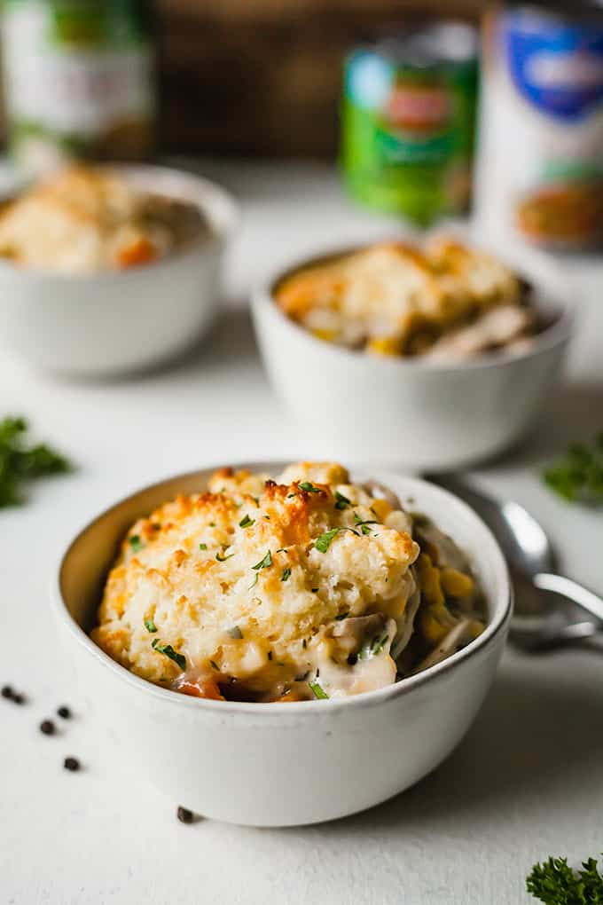 image of three white bowls with biscuit topped vegetarian pot pie