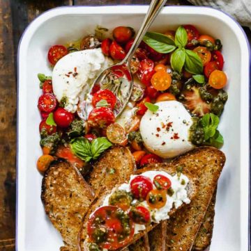 Burrata with Tomatoes, Pesto, and Toast - An easy summer dinner idea that makes the most of your garden fresh produce! #easy #healthy #summer #cheese #tomatoes #burrata #pesto