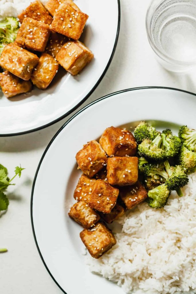 simple tofu on a white plate with broccoli and rice