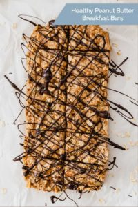 healthy peanut butter breakfast bars on a sheet of parchment paper