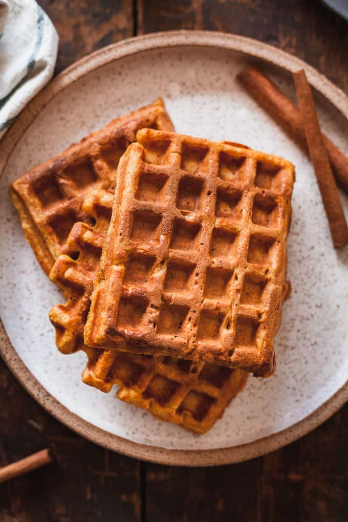 pumpkin waffles on a speckled plate