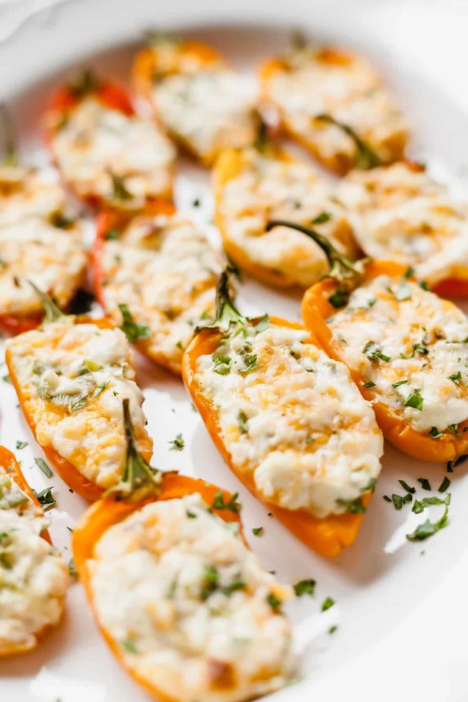cream cheese stuffed mini peppers on a white plate