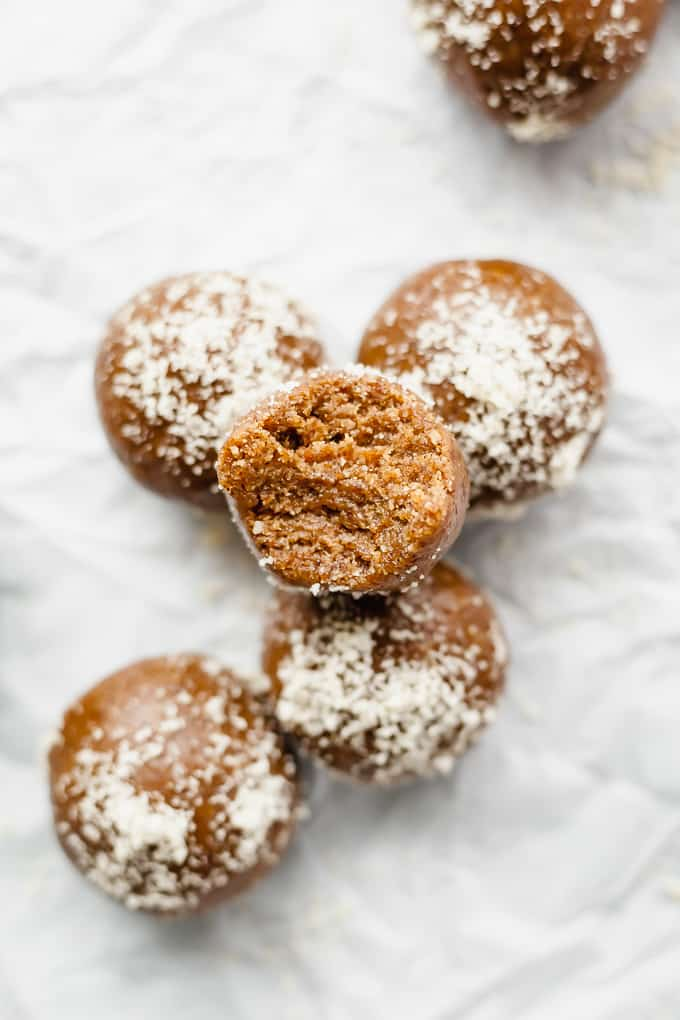 gingerbread energy balls with one that has a bite taken out of it