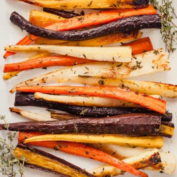 oven roasted carrots with thyme in a white dish