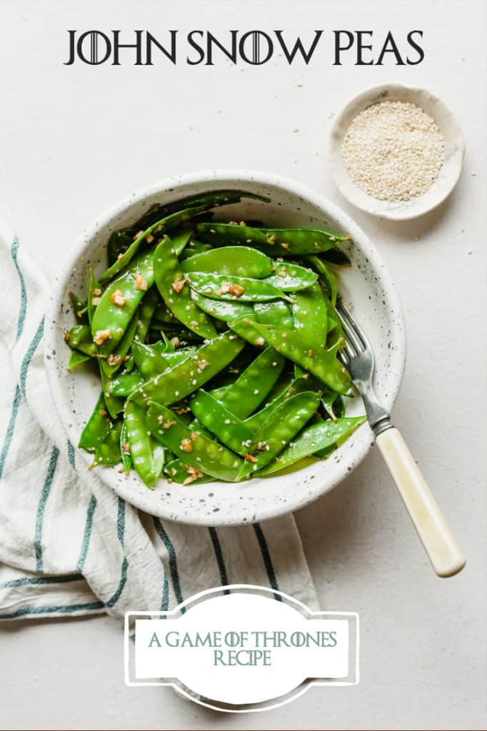 garlic ginger snow peas in a white bowl