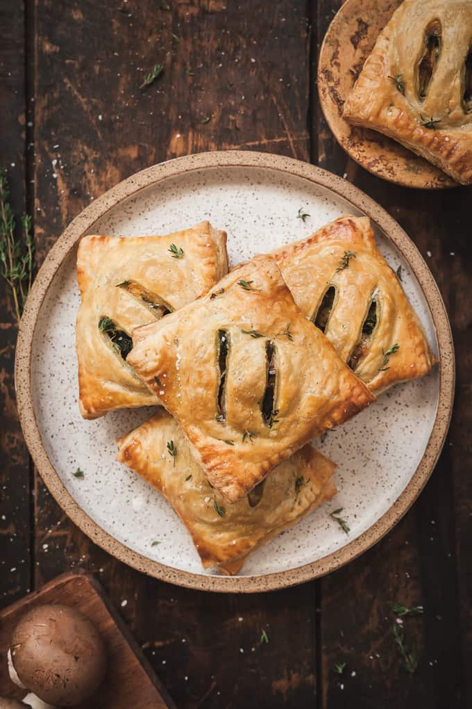 savory vegetarian hand pies on a plate on a wood table, named after hot pie from game of thrones