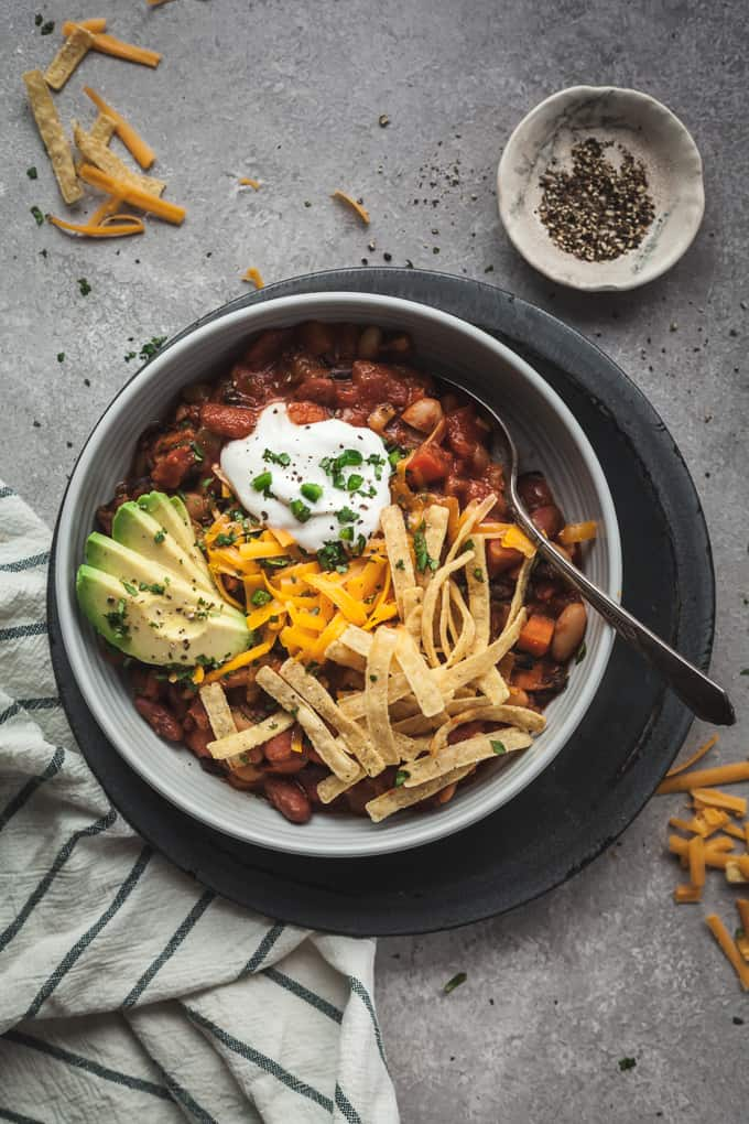 easy vegetarian chili in a blue bowl with a spoon