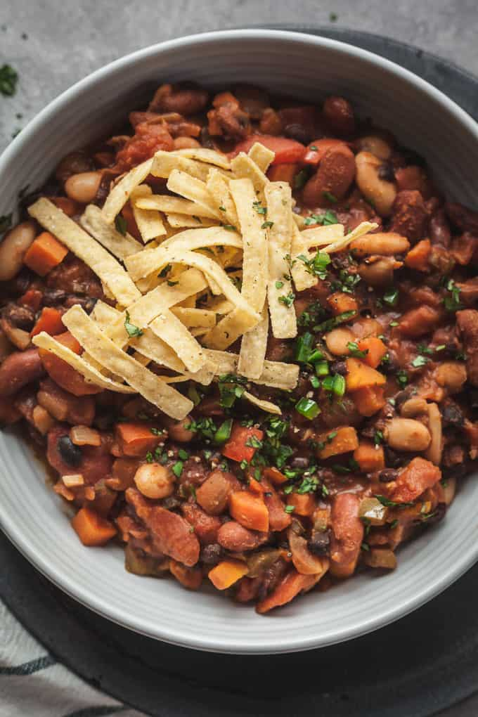 easy vegetarian chili in a blue bowl topped with tortilla strips