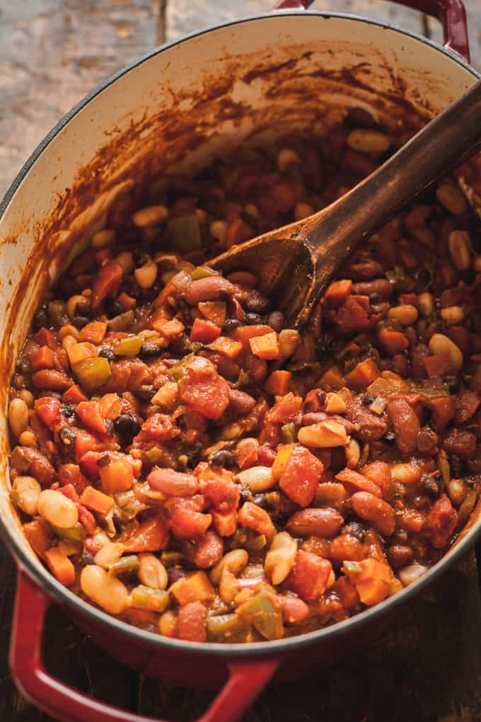 meatless chili recipe in a pot with a wood spoon