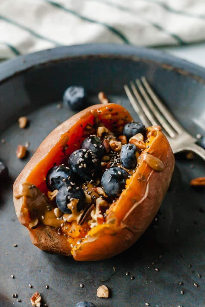 instant pot breakfast stuffed sweet potato on a blue plate with fork