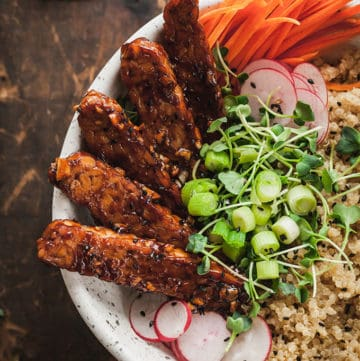 vegan tempeh buddha bowl on a wood table