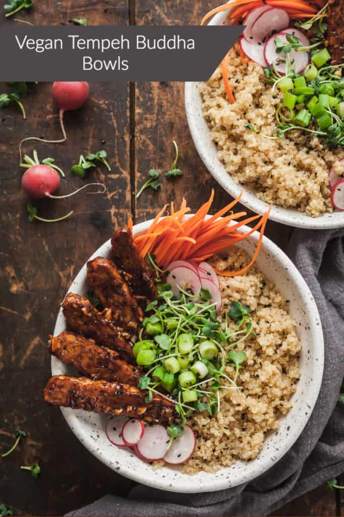 vegan tempeh buddha bowls on a wood table with radishes