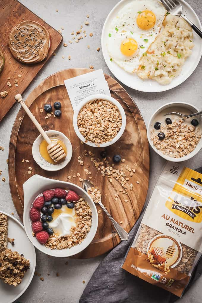 flatlay photo of gluten free breakfast ideas including a yogurt bowl, granola, and eggs
