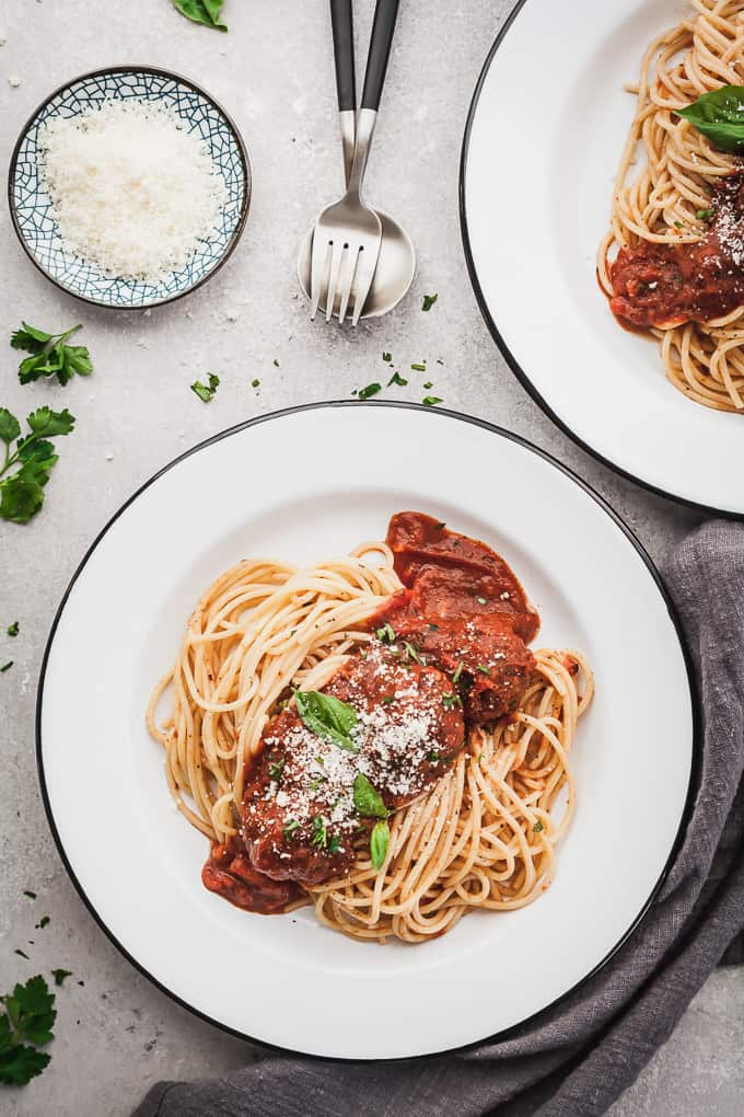 two plates of eggplant meatballs with spaghetti