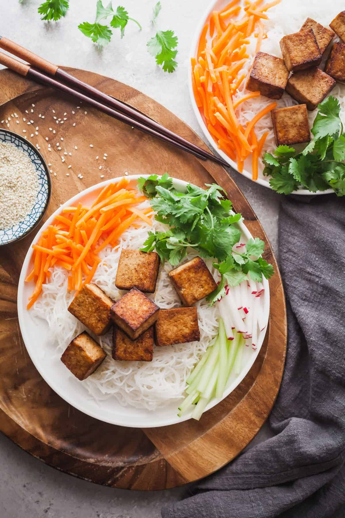 the best tofu in a bed of noodles and salat