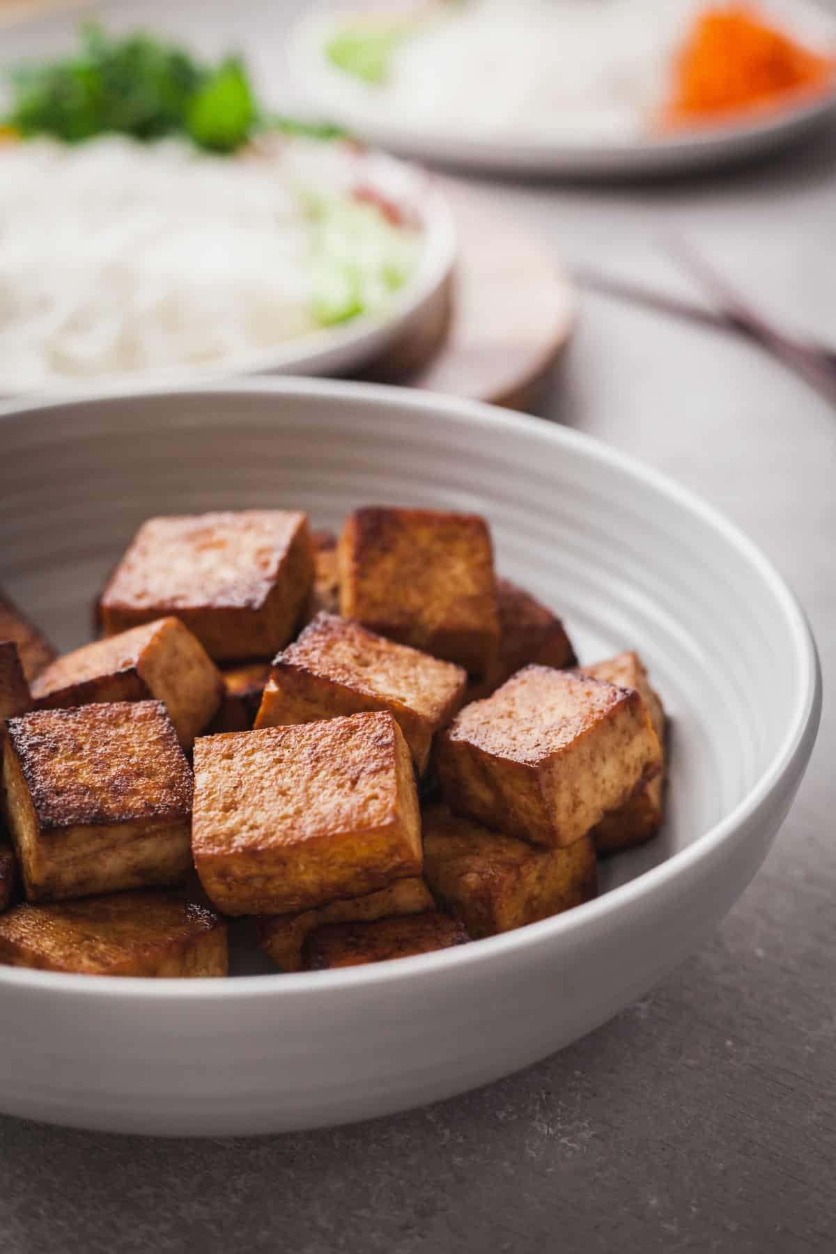 perfectly cooked tofu in a light blue bowl