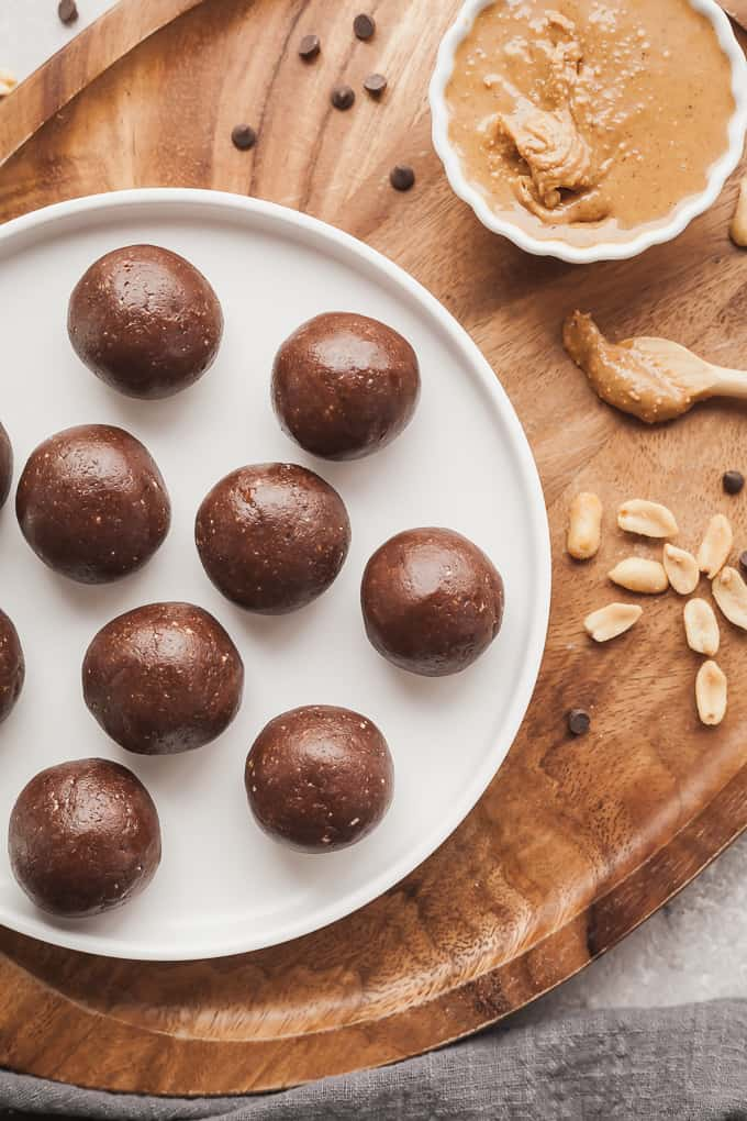 a white plate with chocolate peanut butter energy balls