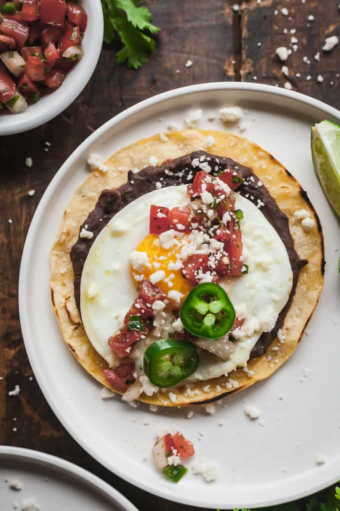 huevos rancheros on a white plate