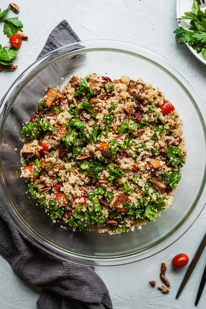 cold quinoa salad in a bowl with a grey napkin