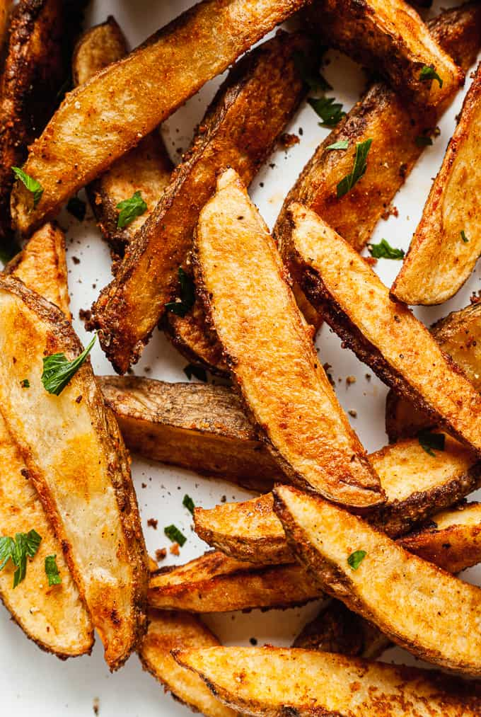 a pan of crispy oven baked potato wedges