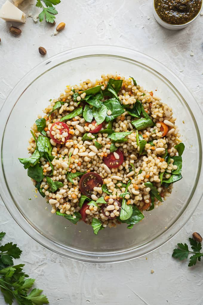 a bowl of israeli couscous pasta salad