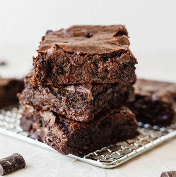 a stack of chocolate brownies on a cooling rack
