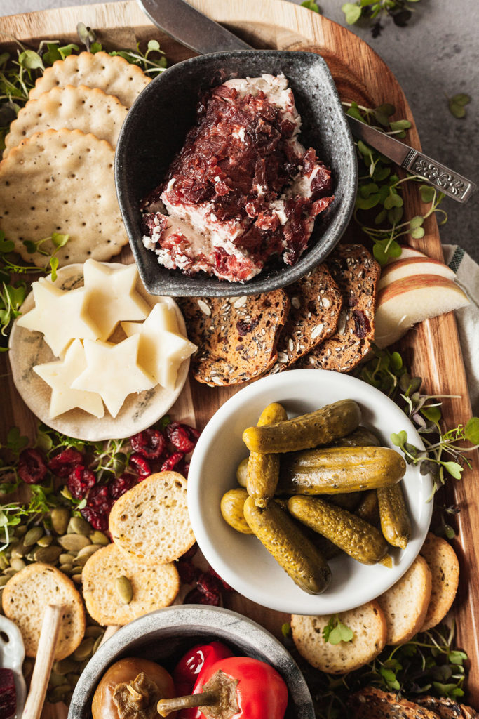 cranberry goat cheese, mini pickles, cheese, and crackers