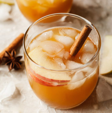apple cider cocktail with a cinnamon stick