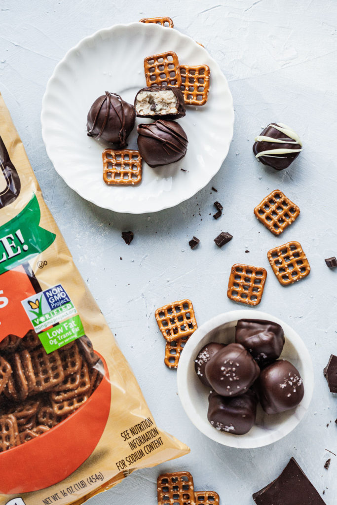 pretzel cookie dough truffles on a plate and in a bowl