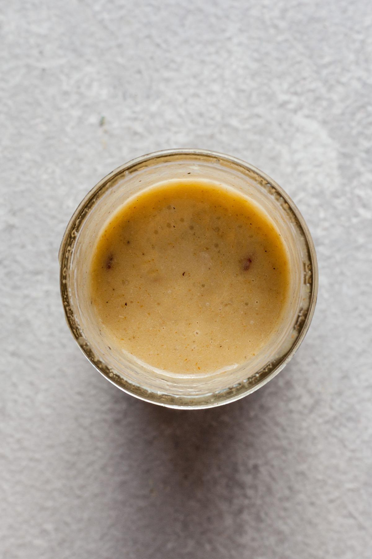 lemon tahini dressing in a mason jar