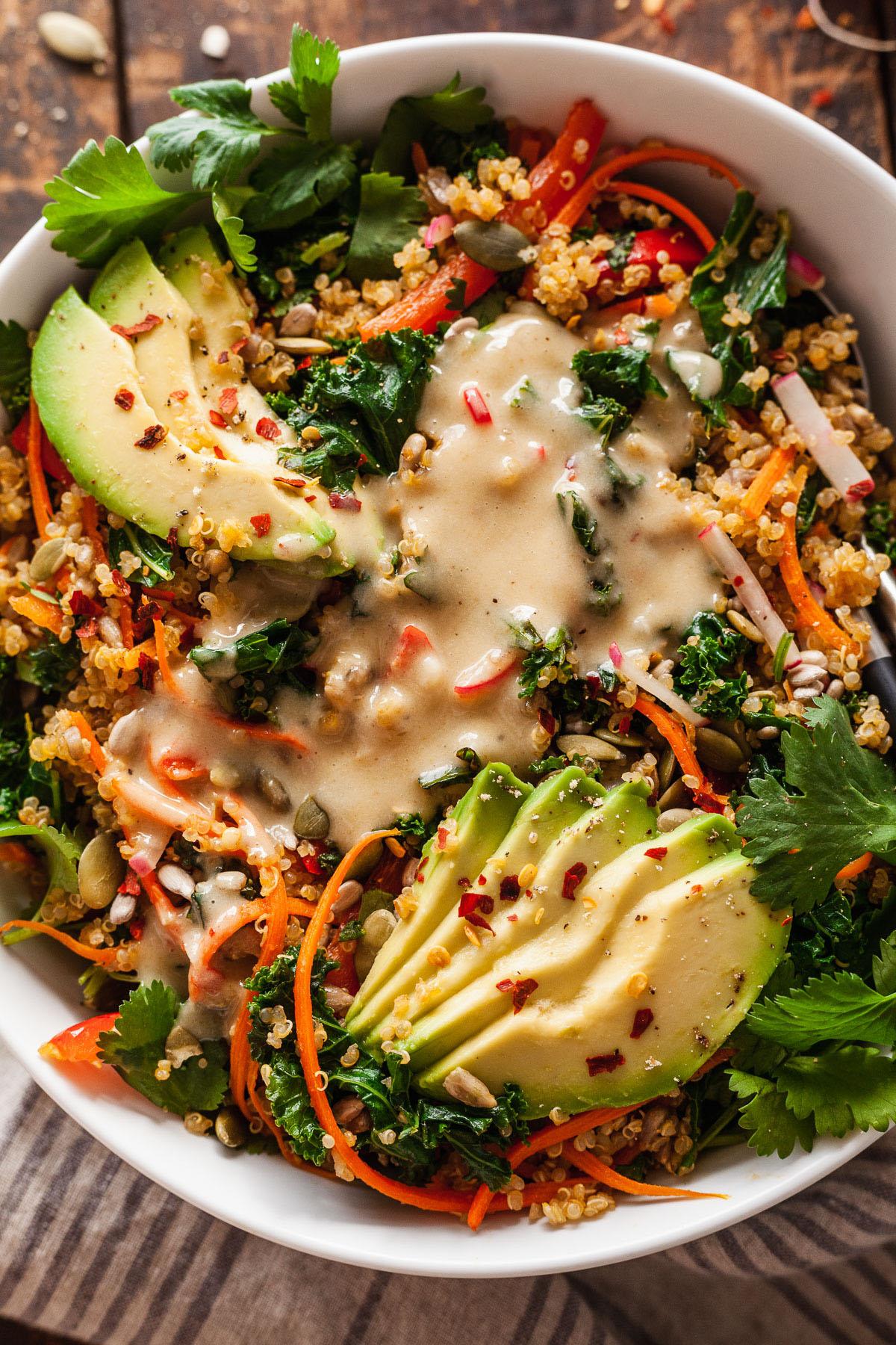 close up of lemon tahini dressing on a vegan salad