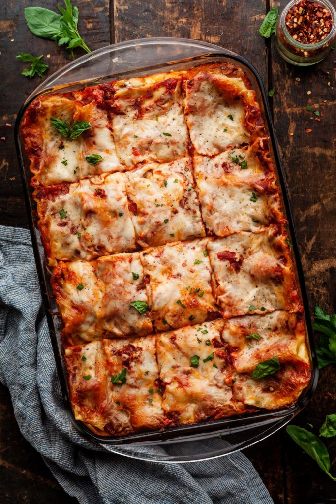roasted vegetable lasagna cut into squares in a pan