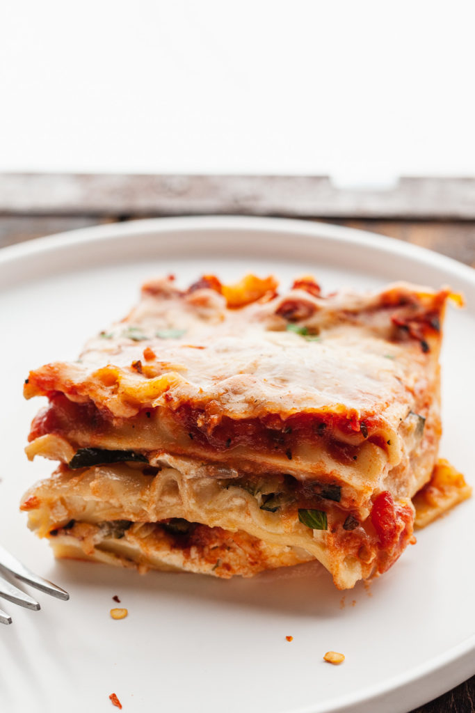 side view of a slice of roasted vegetable lasagna