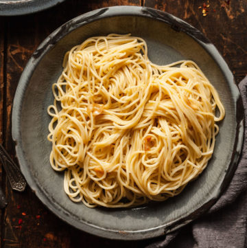 a plate of spaghetti with garlic oil