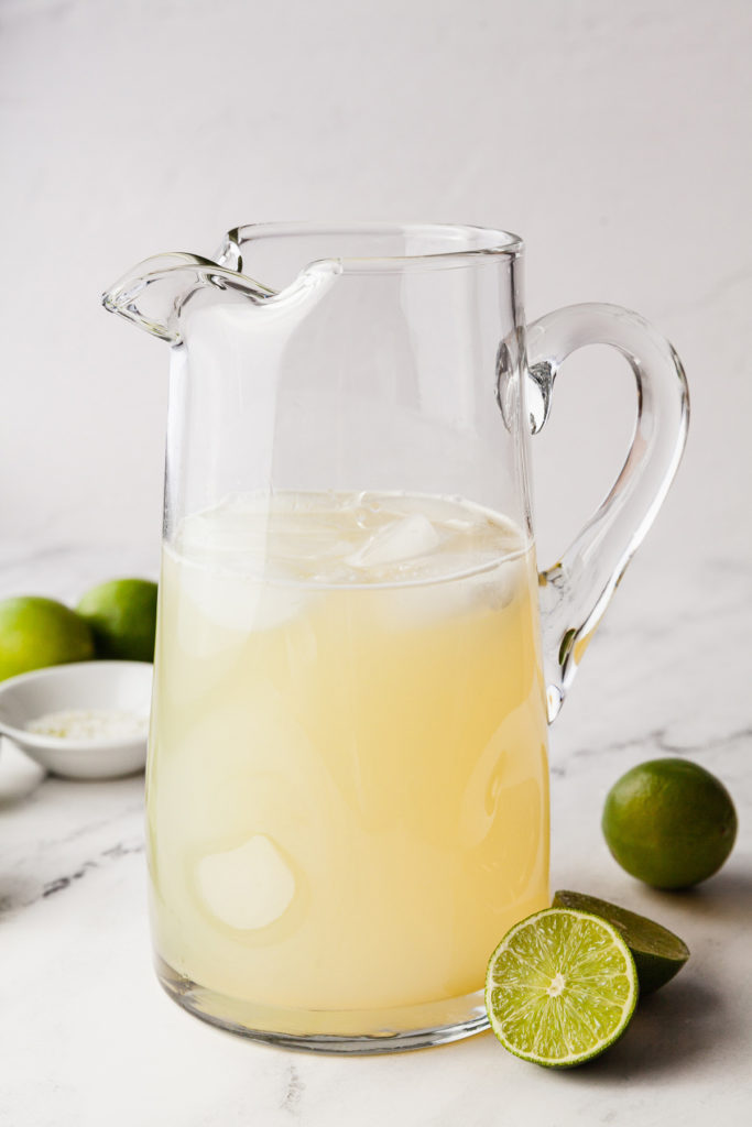 A pitcher of margaritas is just what you need to get your party started! This easy to remember recipe uses only four ingredients to make the perfect classic margarita in a big batch. Great for parties, Cinco de mayo, or ladies' night! #cocktail #bigbatch #margaritas