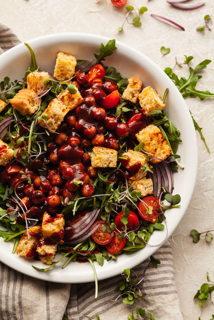 a white bowl of bbq chickpea salad