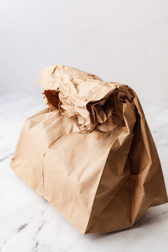 a brown paper bag folded over