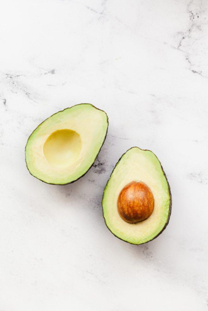 one perfectly ripe avocado cut in half