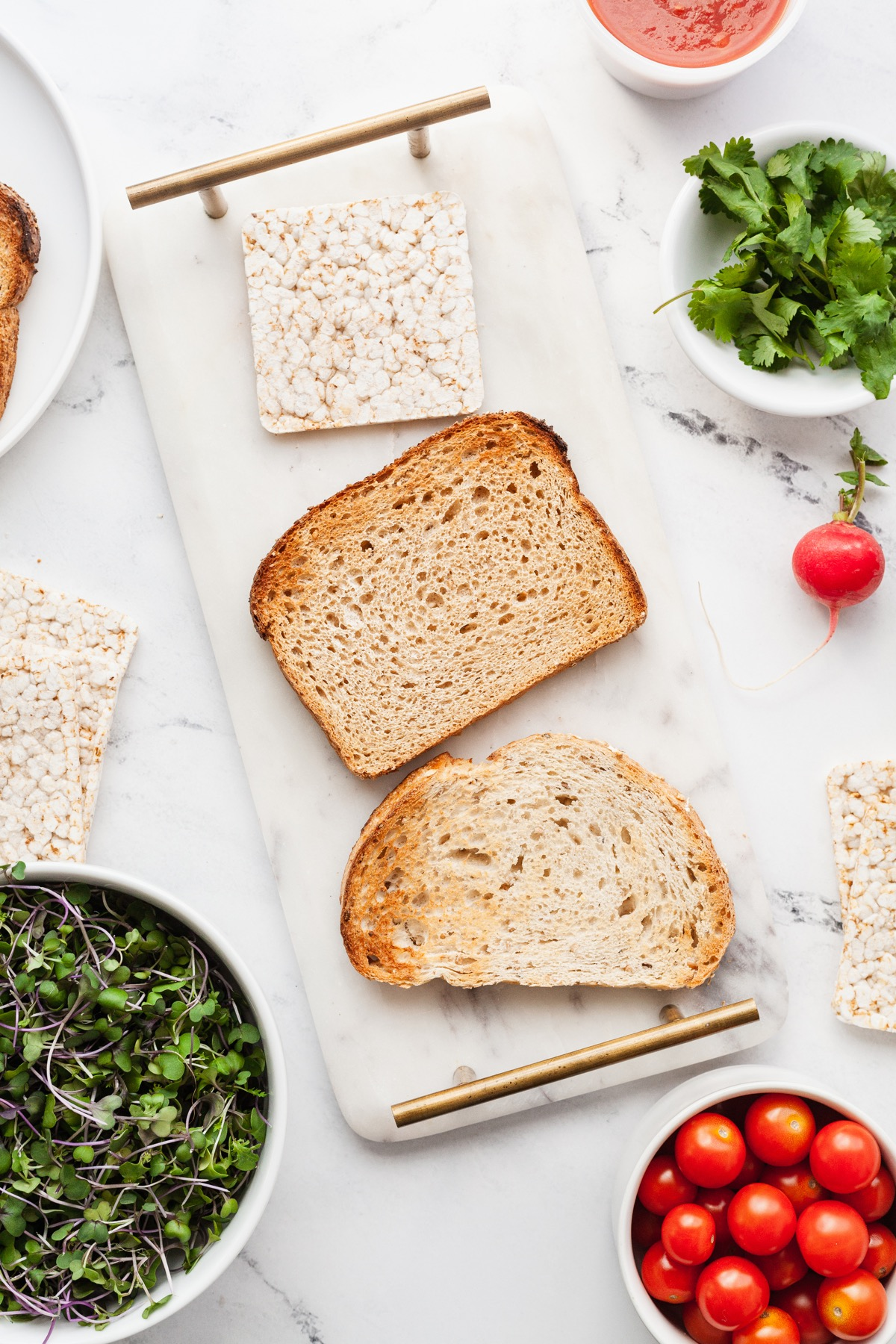 three slices of bread surrounded by veggies