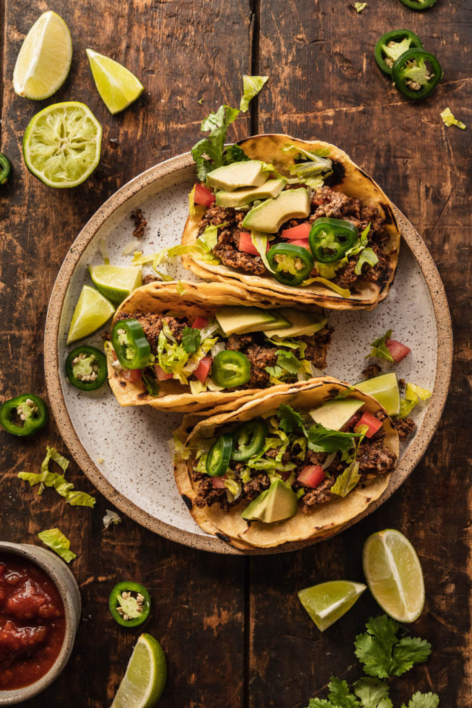 tacos on plate on wood background