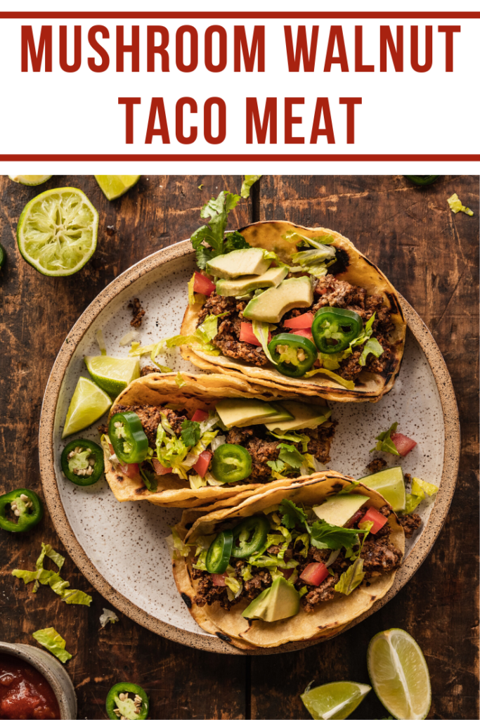 tacos on plate sitting on wooden background