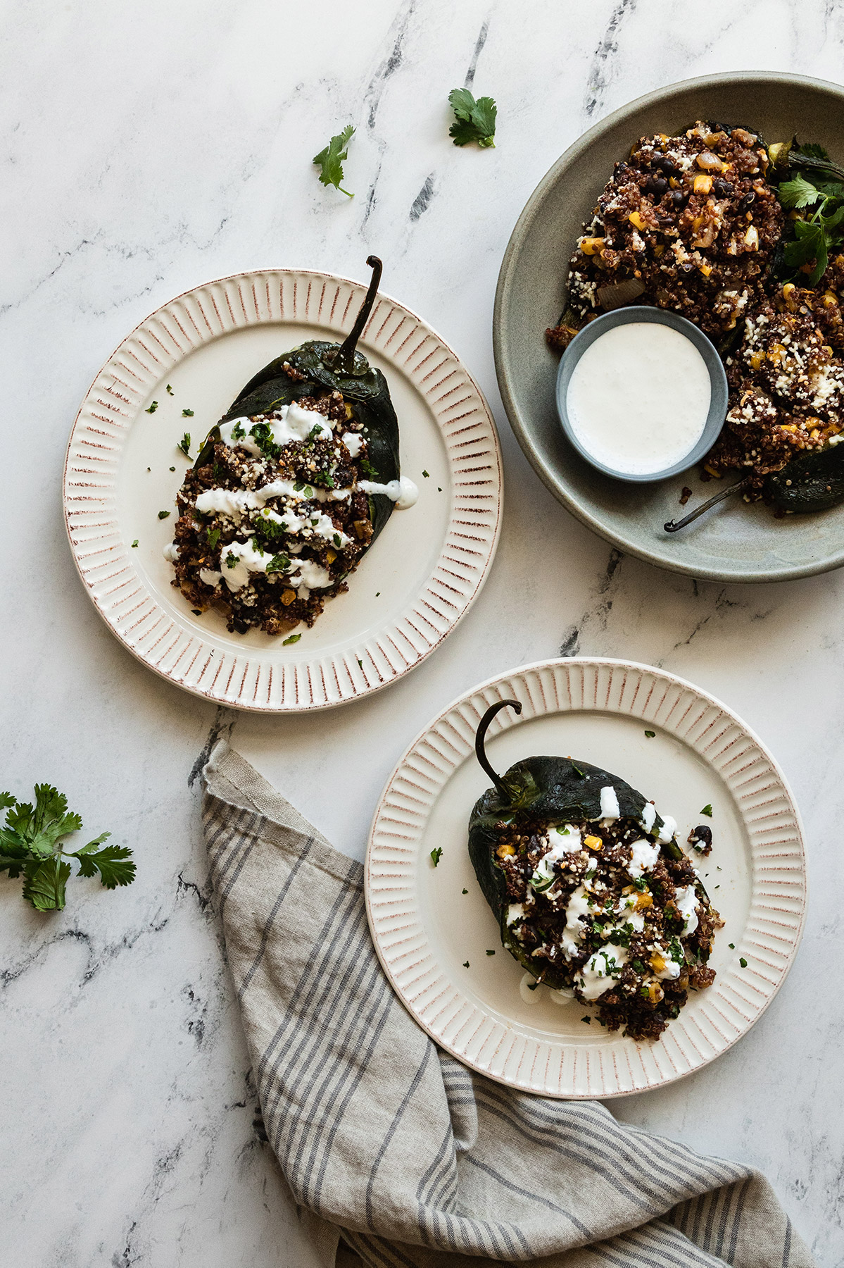 Three plates of vegetarian stuffed poblano peppers